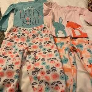Two pairs of new Carters pjs.